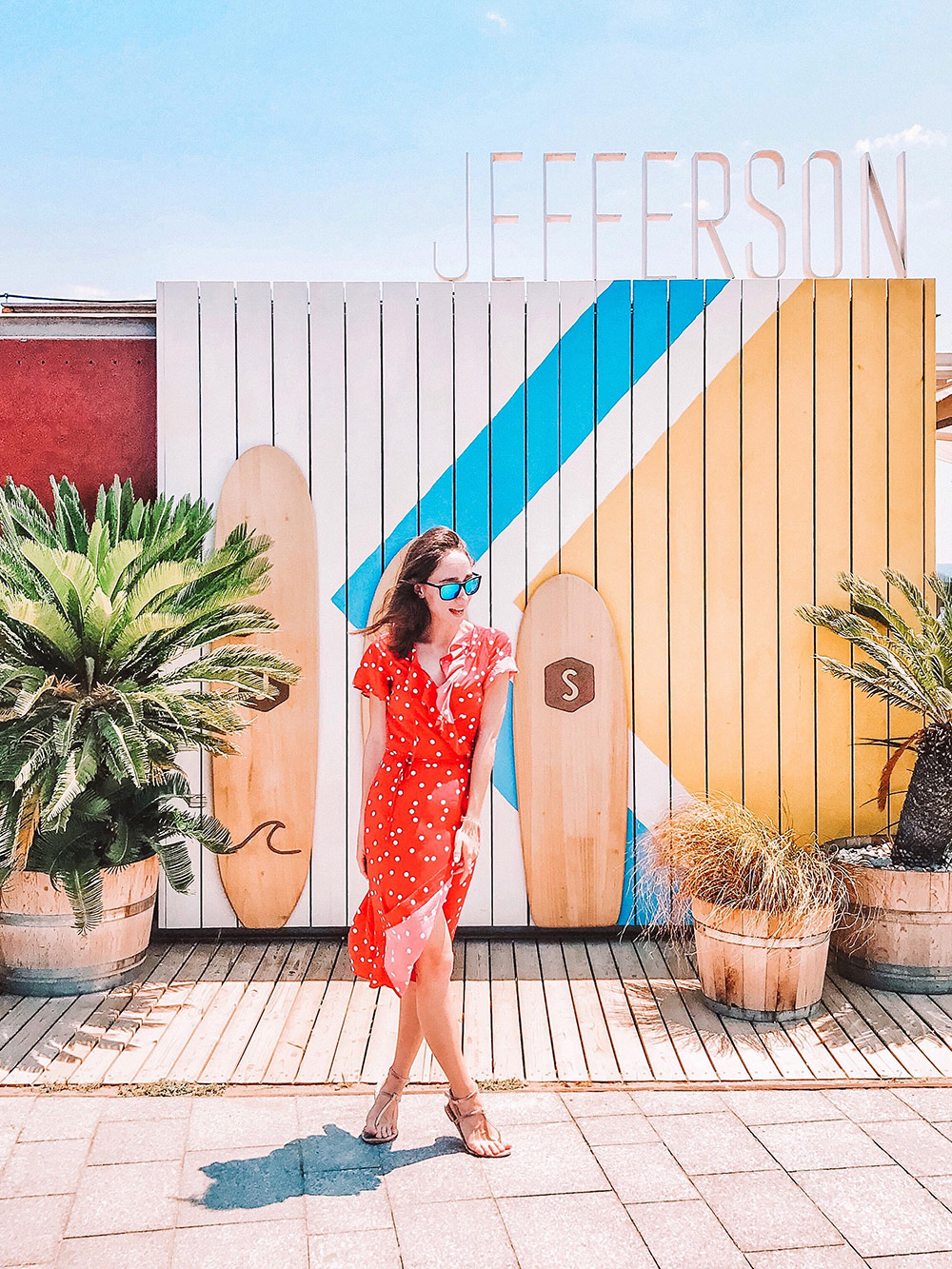 a-girl-in-a-red-dress-standing-against-a-colored-wall-summer-time-concept_t20_2WJbdP